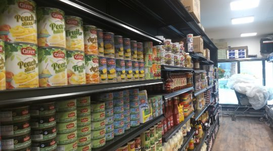 Some of JC Kosher's shelves are fully stocked with staples in its new location, two blocks away from the original store. (Ben Sales)
