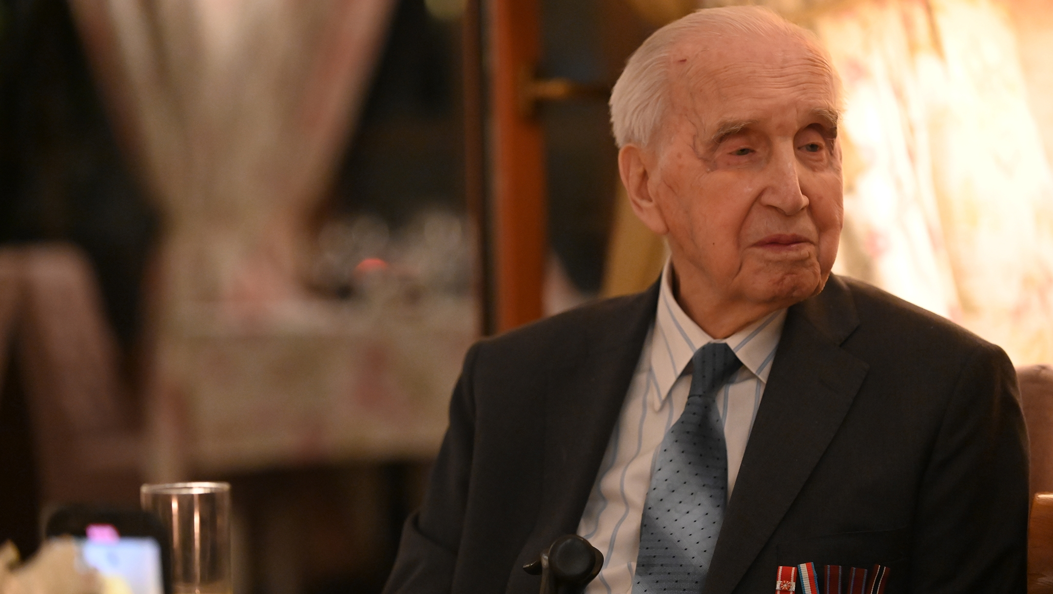 Jozef Walaszczyk, 100, who saved more than 50 Jews during the Holocaust, telling his story at a restaurant in Warsaw, Poland on Jan. 28, 2020. (Cnaan Liphshiz)