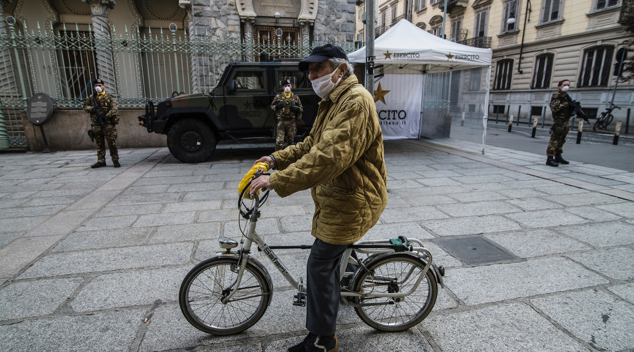 A man rides a bike in front of a synagogue in Turin, Italy, March 18, 2020. (Stefano Guidi/Getty Images)