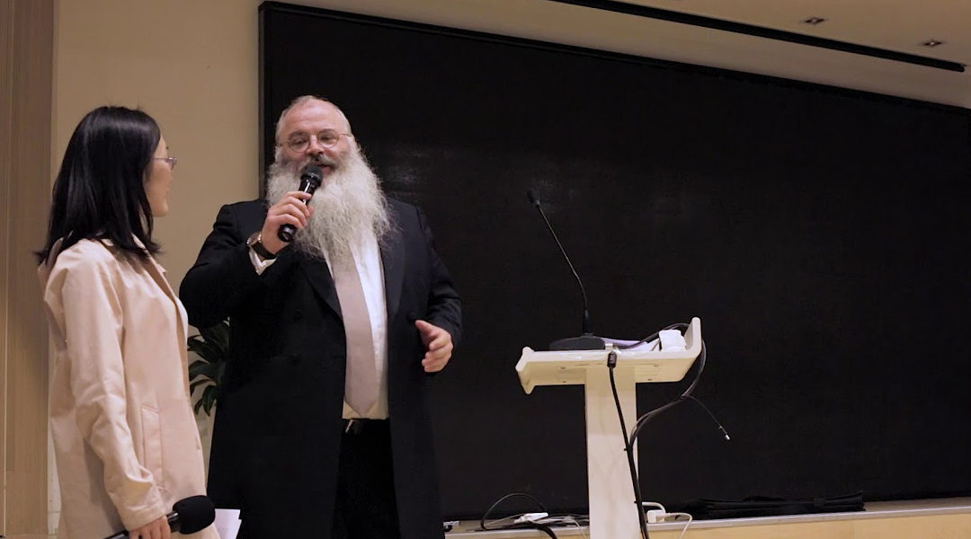 Rabbi Shimon Freundlich speaking at Family Hospital in Beijing, China in 2018. (Courtesy of Chabad China)