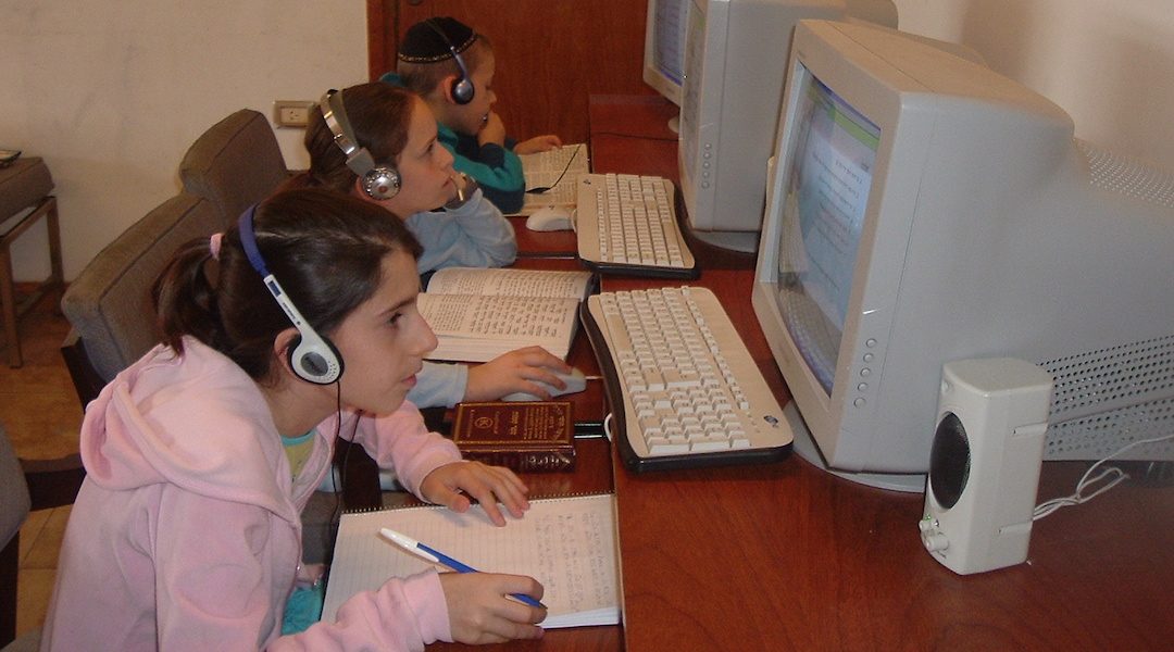 Chabad children in Argentina study in the movement's online school in 2007. During the new coronavirus outbreak, the school has offered guidance to other Jewish schools transitioning to remote learning. (Courtesy of the Nigri International Shluchim Online School)