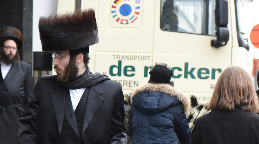 Haredi Jews walking in Antwerp, Belgium on March 16, 2016. (Cnaan Liphshiz)