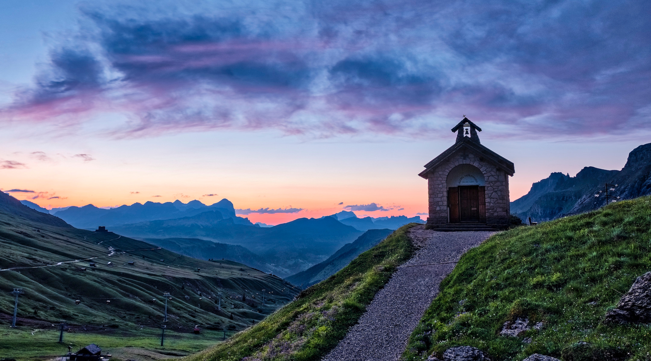 A small chapel close to Pordoi pass in the Canazei area at sunrise with the Setsas mountains in the distance. (Frank Bienewald/Getty Images)