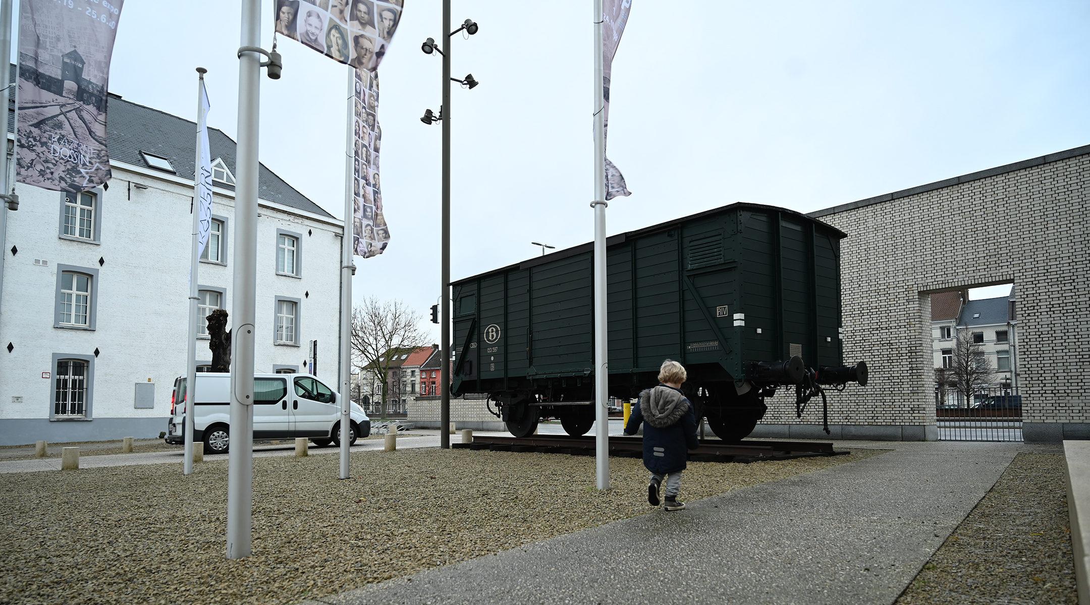 A boy visitng the Kazerne Dossin Holocaust museum in Mechelen, Belgium on Dec. 22, 2019. (Cnaan Liphshiz)