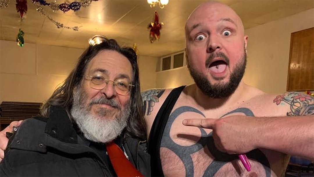 Rabbi Neil Kraft, left, with wrestler Crusher Curtis in London. (Courtesy of Crusher Curtis)