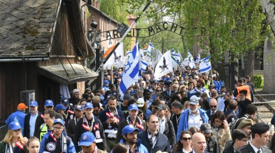 Participants of the March of the Living event exiting a gate in the former Nazi camp Auschwitz in Poland, May 2, 2019. (Courtesy of the International March of the Living)