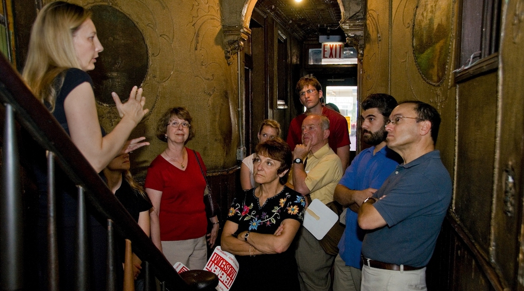 A group takes a tour of the Tenement Museum, which tells the stories of Jewish and other immigrants to New York. The museum has closed temporarily and shedded most of its staff. (Courtesy of the Tenement Museum)