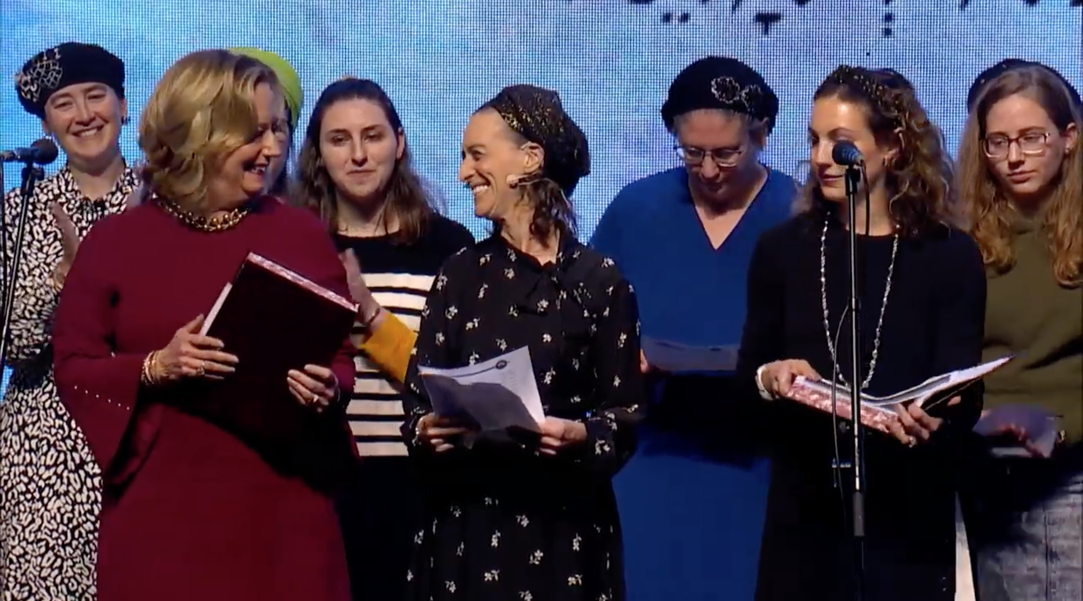 Women celebrate completing the seven-and-a-half-year cycle of Talmud study at a ceremony held by the organization Hadran in Jerusalem in January. (Screenshot from YouTube)