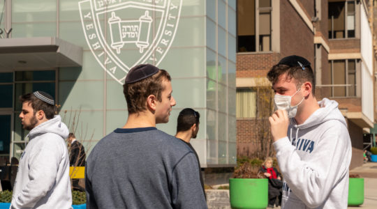 A Yeshiva University student wears a face mask on the grounds of the university on March 4, 2020 in New York City. (David Dee Delgado/Getty Images)