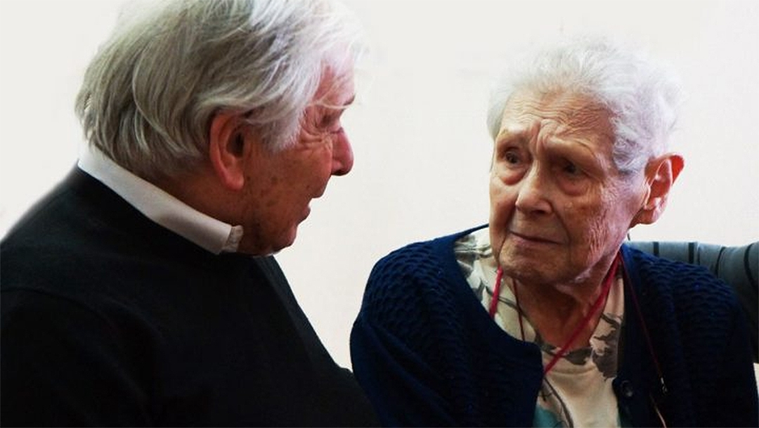 Frida Wattenberg speaking with her brother, Charles Smiétanski, at the Memorial for the Shoah in Paris, France on Jan. 29, 2019. (Courtesy of the Memorial for the Shoah)
