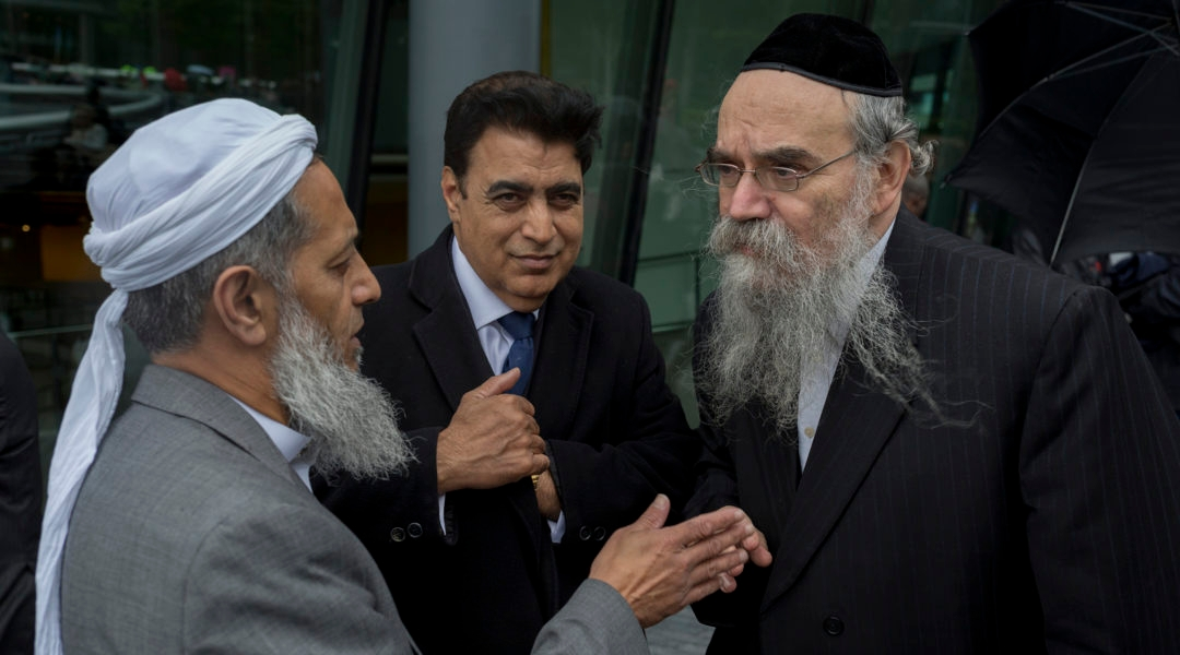 Rabbi Avrohom Pinter, right, speaking with other community leaders in London, the United Kigdom on June 5, 2017. (Richard Baker/In Pictures via Getty Images Images)
