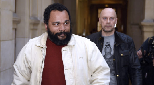 Dieudonne M'bala M'bala, left, and Alain Soral arriving at the Paris courthouse on March 12, 2015, for Soral's trial for inciting hatred against Jews. (Loic Venance/AFP via Getty Images)