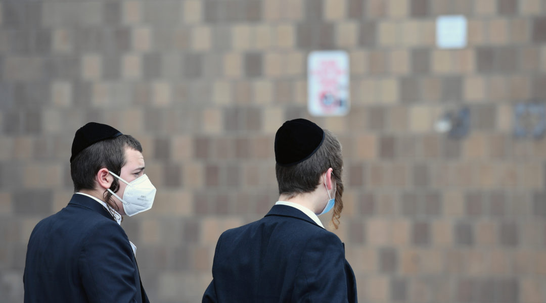 Two Orthodox men wear facemasks in New York City on March 31, 2020. The new coronavirus has spread at an especially high rate through Orthodox neighborhoods in New York. (Angela Weiss/AFP via Getty Images)