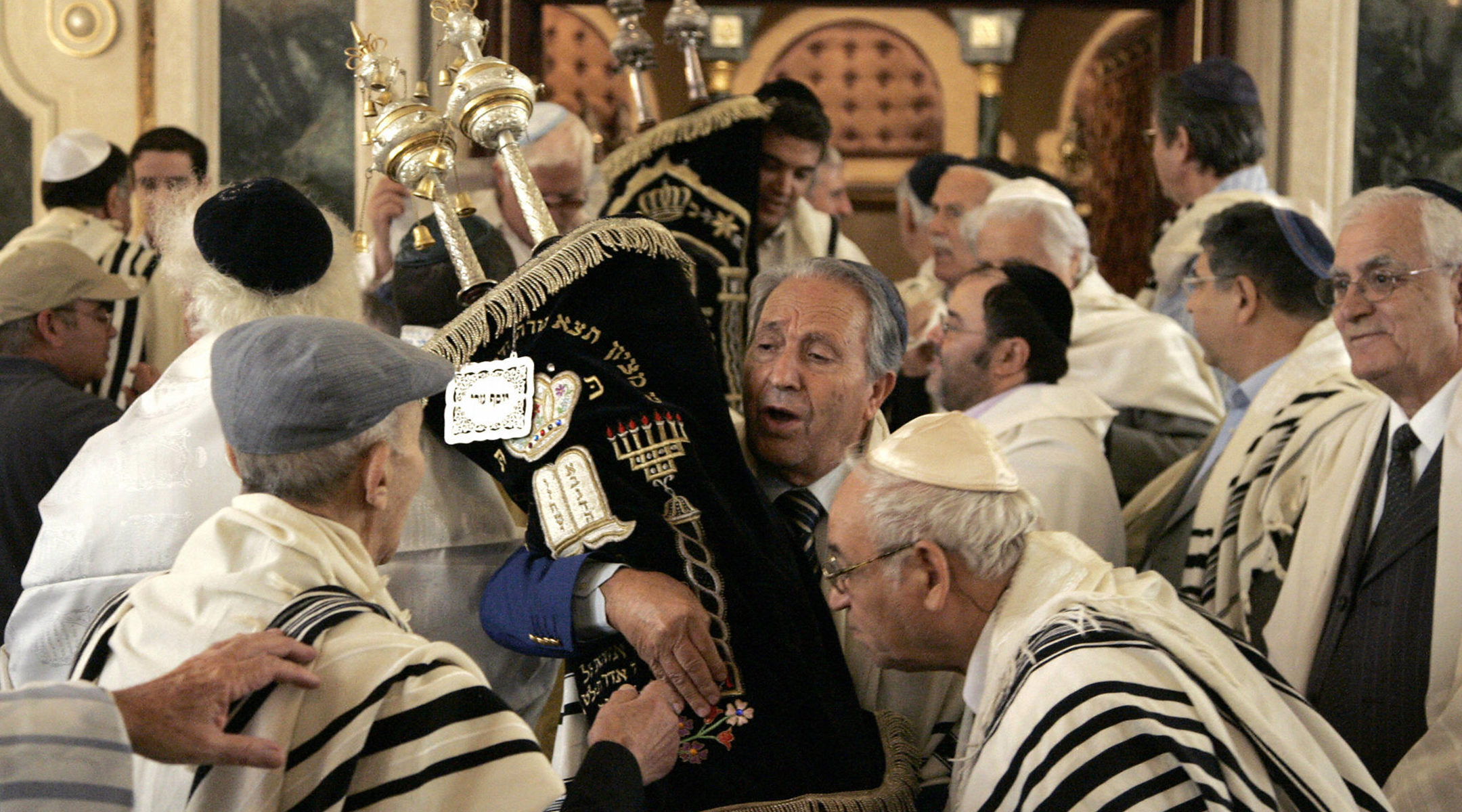 Members of Morocco's Jewish community kiss Torah scrolls at Simchat Torah at the Great Synagogue of Casablanca, Morocco on Oct. 5, 2007. (Abdelhak Senna/AFP via Getty Images)