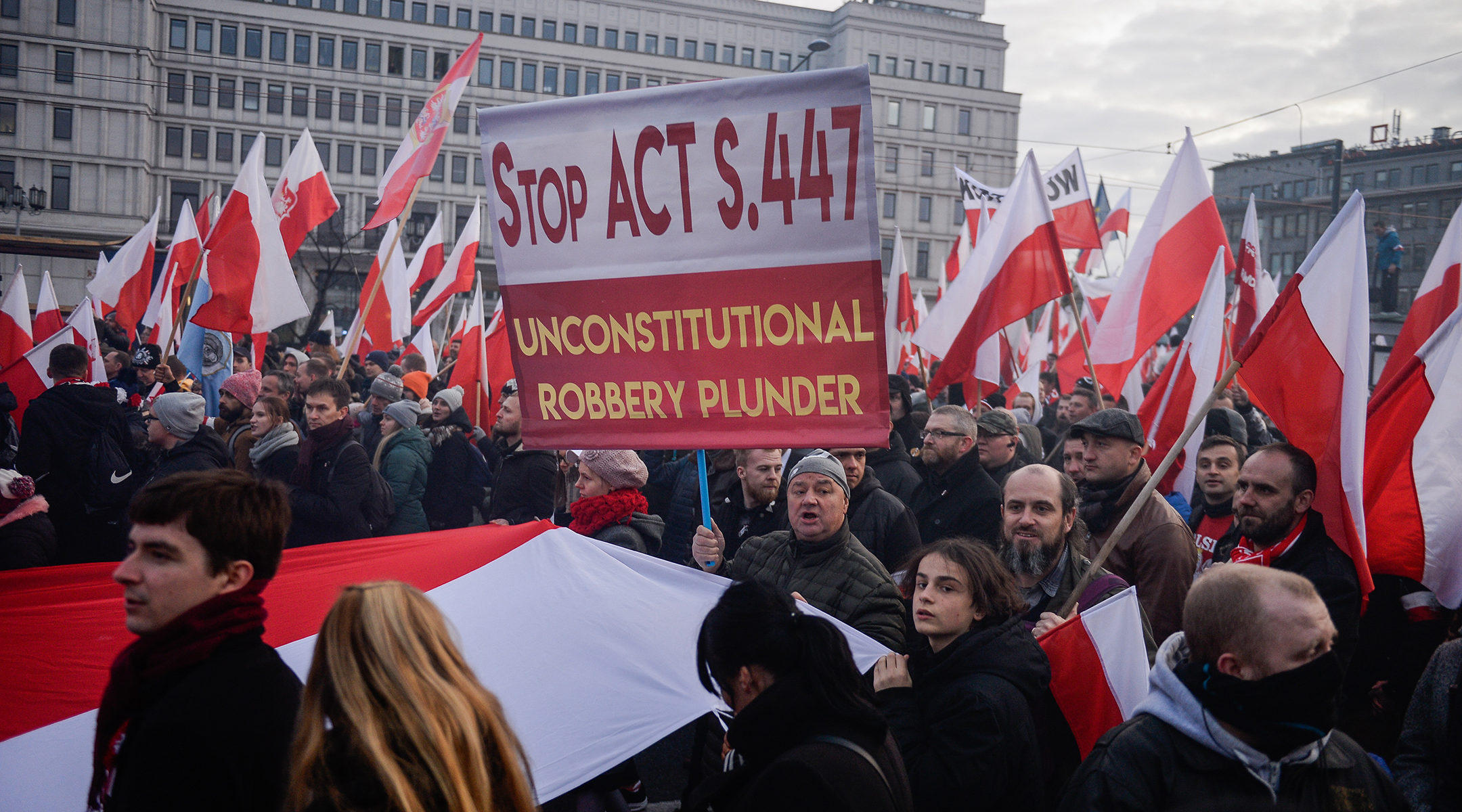 Demonstrators protesting US legislation requiring the return of property stolen from Jews in the Holocaust in Warsaw, Poland on Nov. 11, 2019. (Omar Marques/SOPA Images/LightRocket via Getty Images)