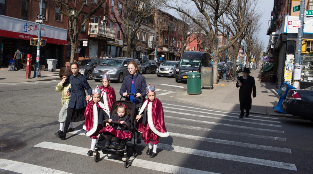 A Hasidic family, dressed up for Purim, crosses the street on March 10, 2020 in the Brooklyn neighborhood of Williamsburg. (Andrew Lichtenstein/Getty Images)