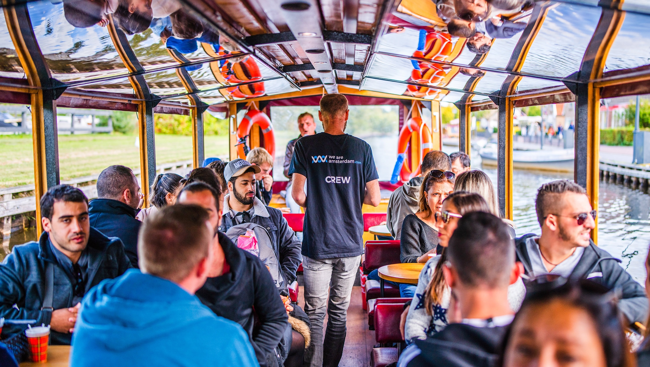 Tourists participate in a We Are Amsterdam canal tour operator in the center of Amsterdam, the Netherlands in 2019. (Courtesy of We Are Amsterdam)