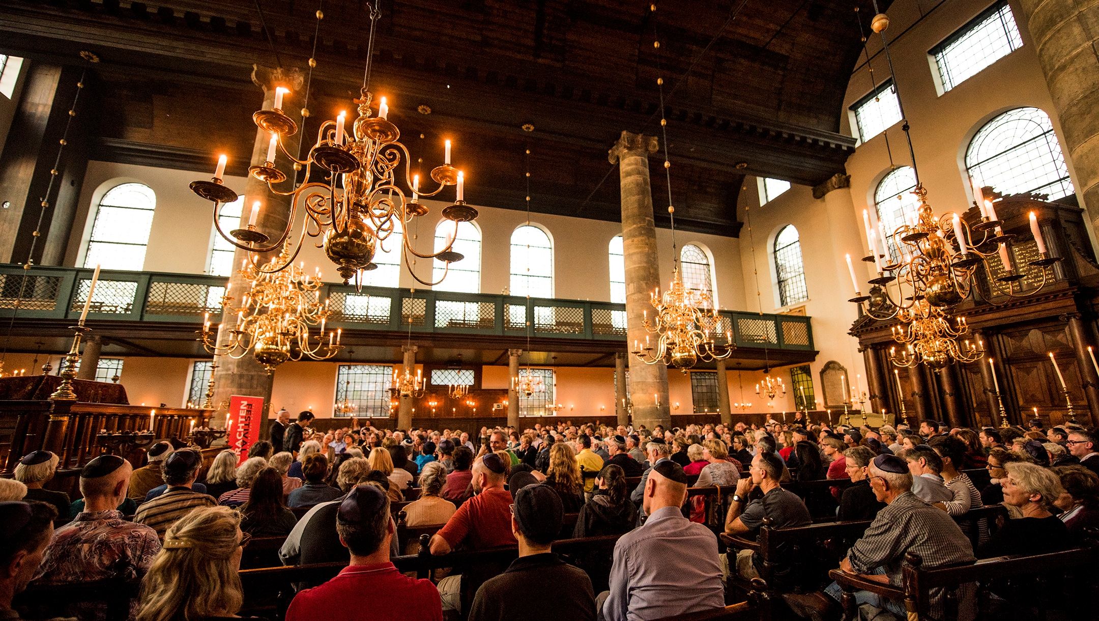 People attend a concert inside the Portuguese Synagogue at the Jewish Cultural Quarter of Amsterdam, the Netherlands on Aug. 17, 2017. (Cnaan Liphshiz)