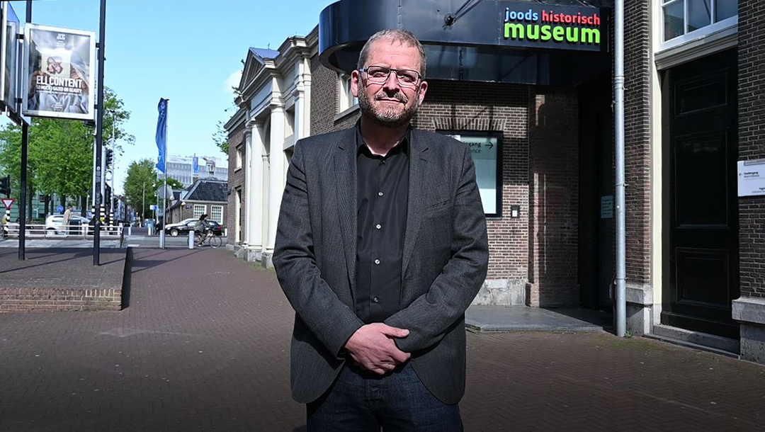 Emile Schrijver, director of the Jewish Cultural Quarter, stands outside that institution in Amsterdam, the Netherlands on May 4, 2020. (Cnaan Liphshiz)