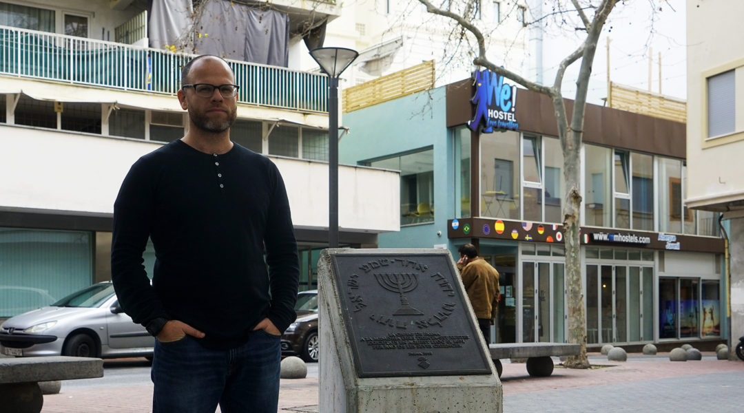 Dani Rotstein stands next to a monumnet commemorating the Jews of Palma de Mallorca, Spain on Feb. 13, 2019. (Cnaan Liphshiz)