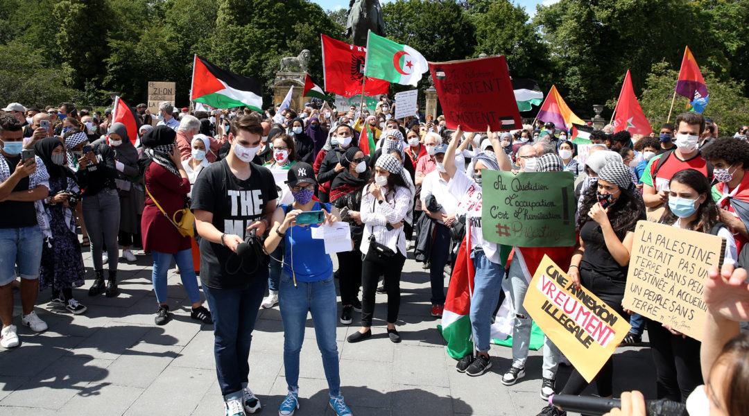 Protesters demonstrate against Israel's plan to apply its civilian laws in the West Bank during a rally in Brussels, Belgium on June 28, 2020. (Dursun Aydemir/Anadolu Agency via Getty Images)