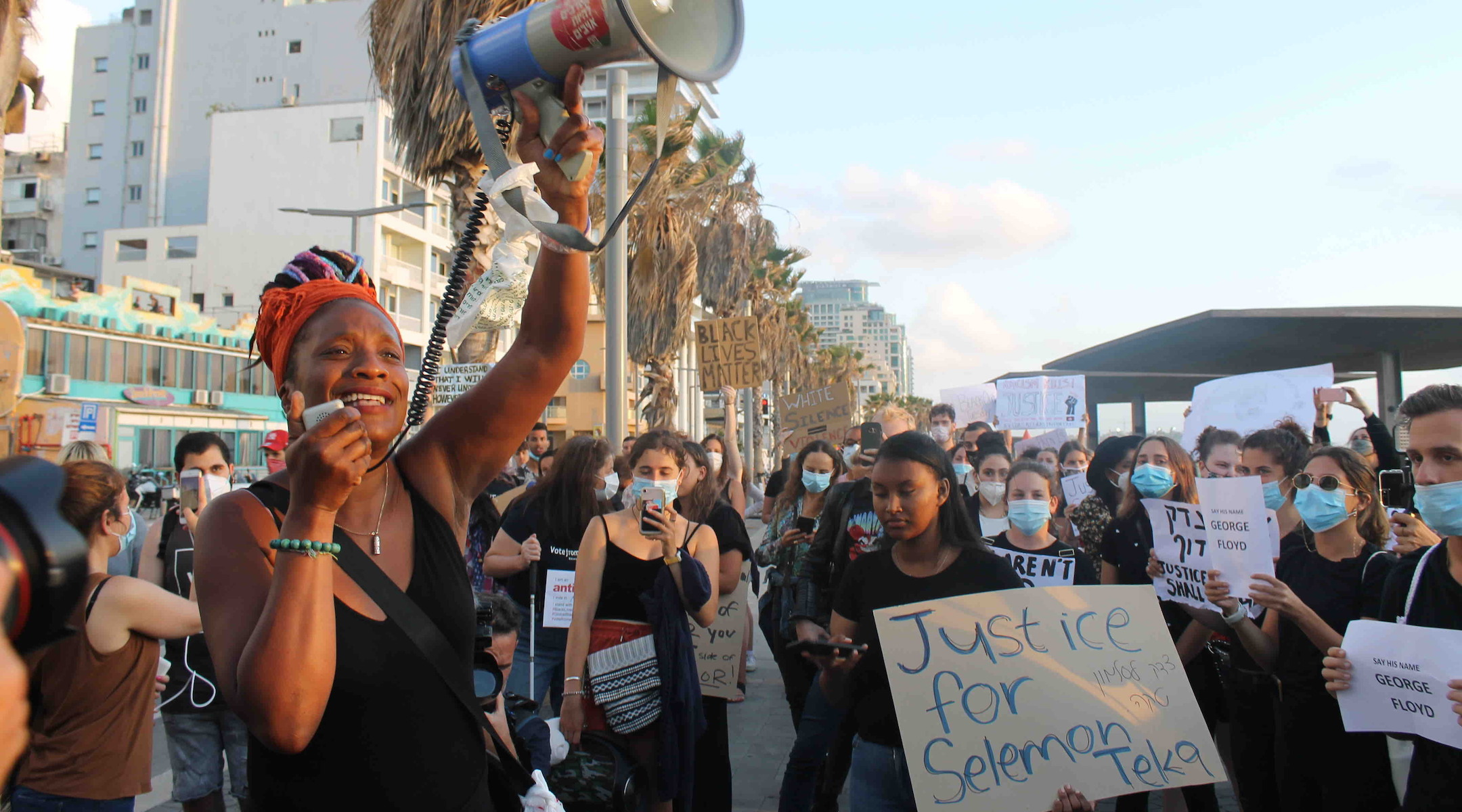 Hundreds of Israelis, angry with police violence at home, protest the George Floyd killing in...