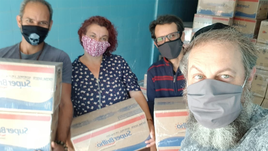 Rabbi Gilberto Ventura, right, and volunteers prepare to dispatch food packages to a needy residents of Sao Paulo, Brazil on May 27, 2020. (Courtesy of Sinagoga sem Fronteiras)