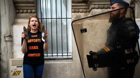 A protester shouts slogans in front of the Chamber of Commerce and Industry of Toulouse in protest to the coming of the Israël's ambassador in France, Aliza Ben-Noun, on May 23, 2018. (Alain Pitton/NurPhoto via Getty Images)