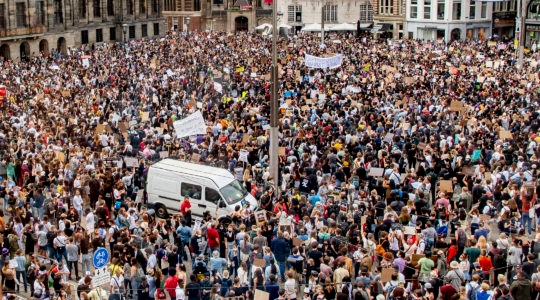 Thousands of protesters defying social distancing measures at a protest over the death of George Floyd on Dam Square in Amsterdam, the Netherlands on June 1, 2020. (Robin Utrecht/SOPA Images/LightRocket via Getty Images)