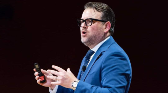 Evan Bernstein, shown here speaking to students at Harvard University, is the new CEO of the Community Security Service, which trains congregants in how to protect their synagogues. (Courtesy of Harvard University)