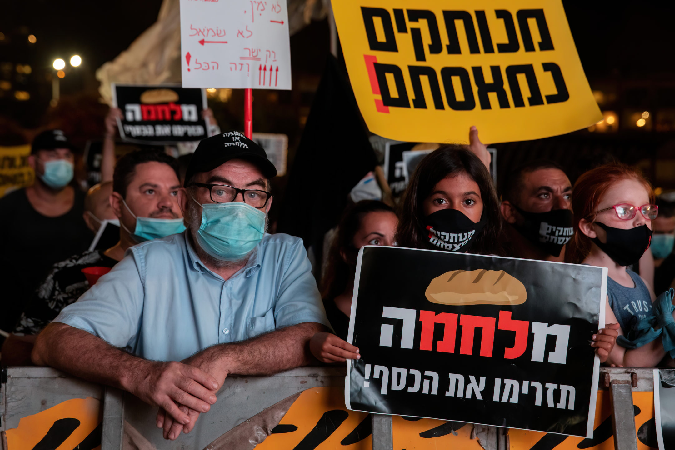 Israelis demonstrate against country's response to economic crisis as COVID-19 cases mount