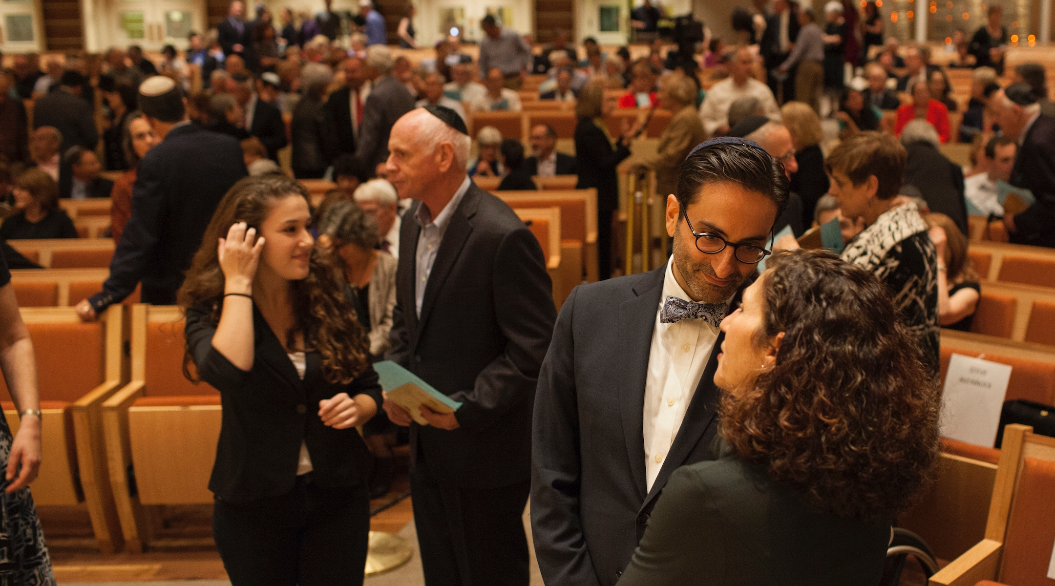 People crowd the sanctuary of Adas Israel Congregation, a Washington, D.C., Conservative synagogue, for a buidling dedication ceremony on October 2, 2013. The synagogue is maintaining its annual dues this year but expects a budget shortfall. (Jared Soares/The Washington Post via Getty Images)
