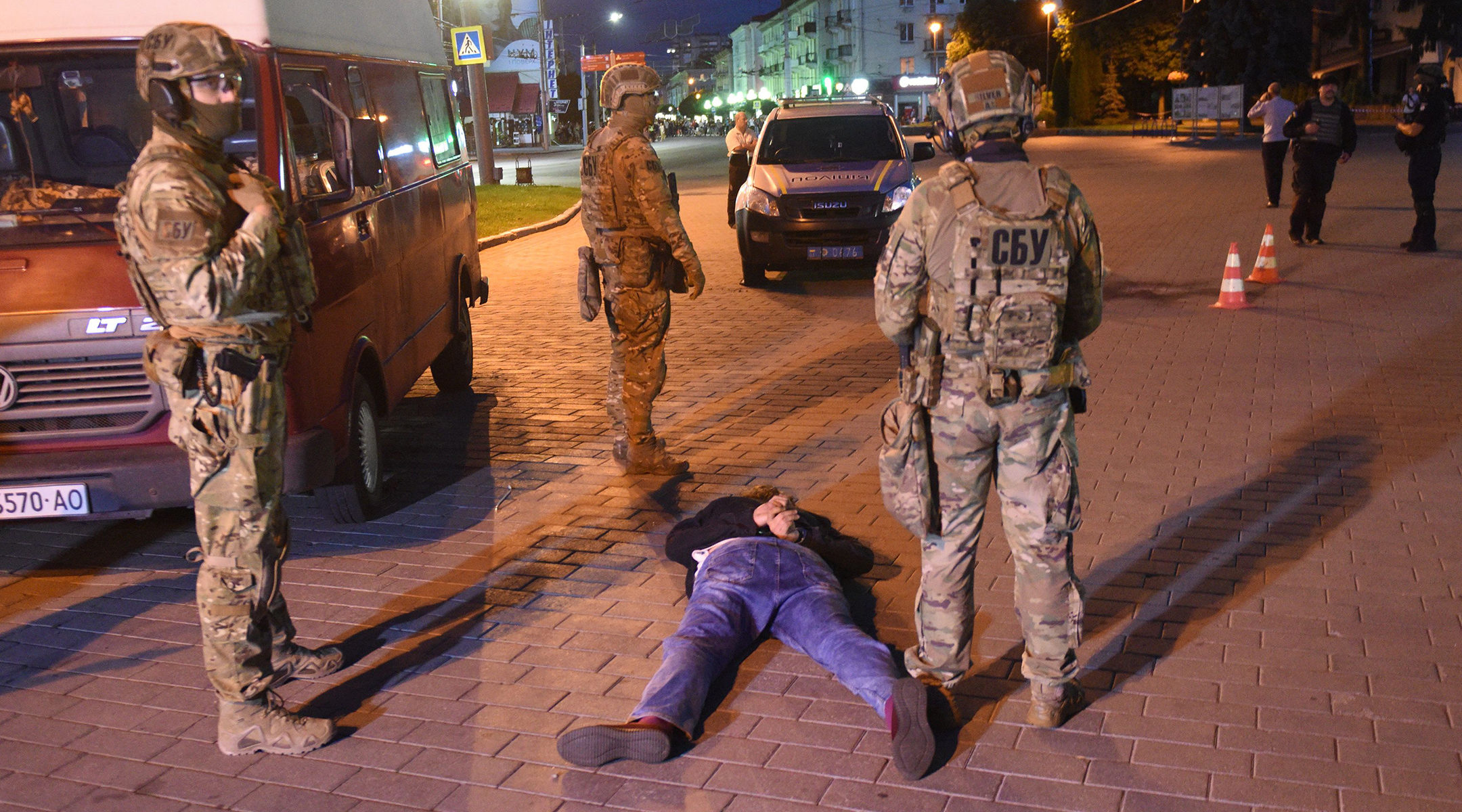 Ukrainian police officers detain a suspected hijacker in Lutsk, Ukraine on July 21, 2020. (Yuriy Dyachyshyn/AFP via Getty Images)