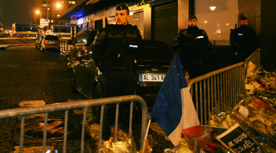 Police officers guard the scene of the Hyper Cachere terrorist attack in Paris, France on Jan. 10, 2015. (Cnaan Liphshiz)