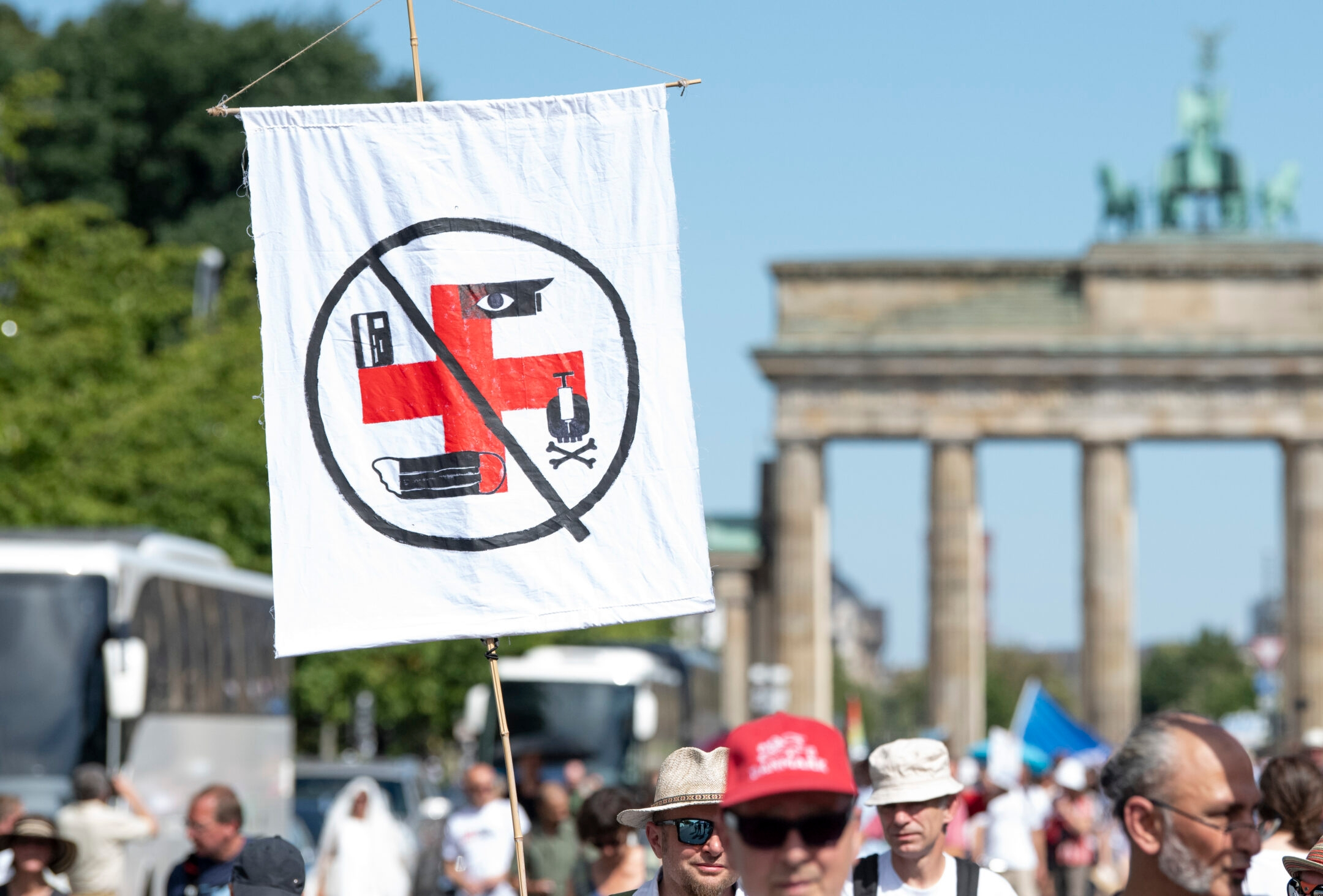 Berlin rally against coronavirus rules features neo-Nazi supporters, anti-Semitic displays