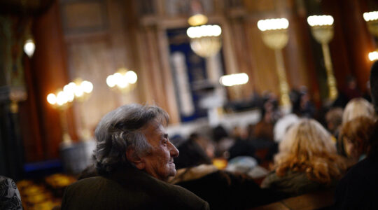 A woman from the Bulgarian Jewish community attends a commemoration ceremony at Sofia's synagogue on March 10, 2013 (Dimitar Dilkoff/AFP via Getty Images)