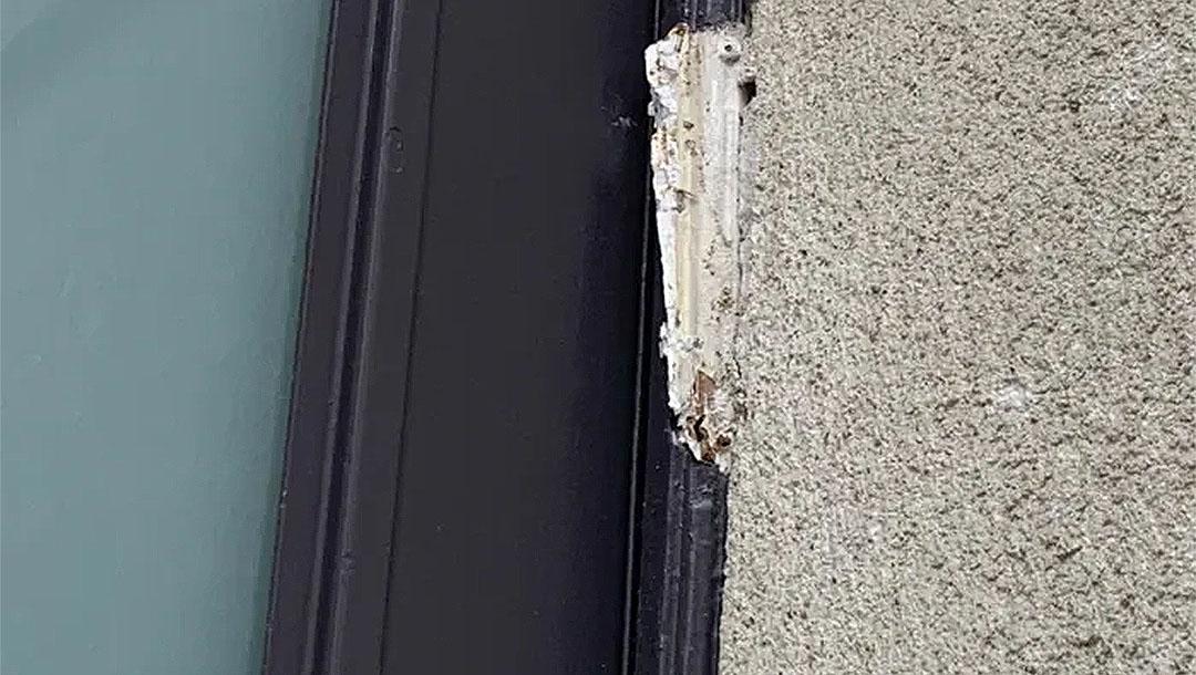A piece of a broken mezizah hangs on the door frame of the Yismah Moché Synagogue in Paris, France on Aug. 14, 2020. (BNVCA)