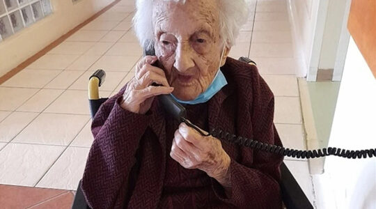 Rosalie Wolpe speaks to a relative on the phone on her 111th birthday at a retirement home in Cape Town, South Africa on Aug. 25, 2020. (David Wolpe)