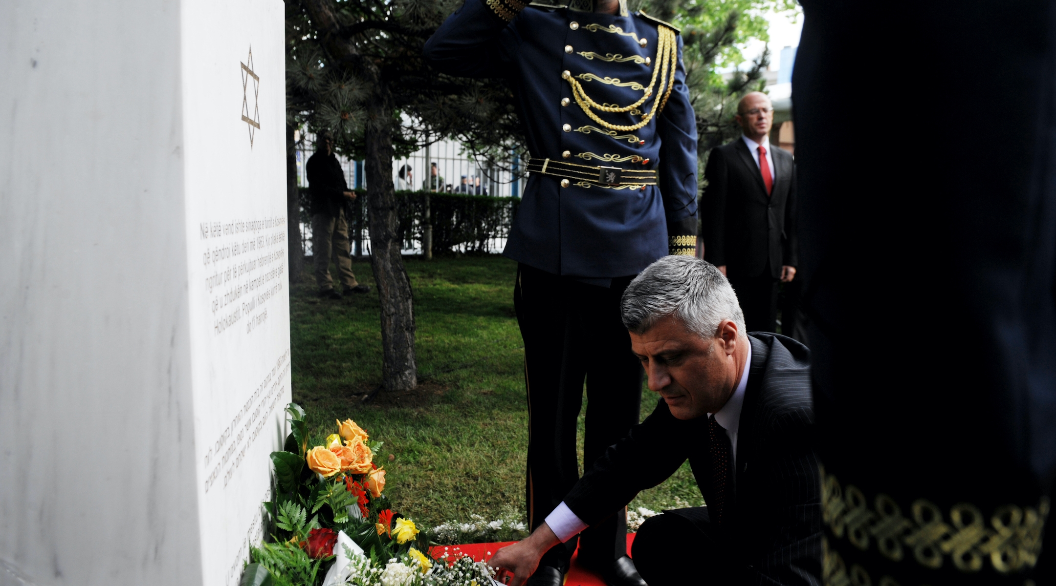 Kosovo Prime Minister Hashim Thaci places flowers in Pristina, May 23, 2013, on the commemorative plaque remembering Kosovo Jews that perished in Holocaust, at the site where the last synagogue of Kosovo stood until 1963. (Armend Nimani/AFP via Getty Images)