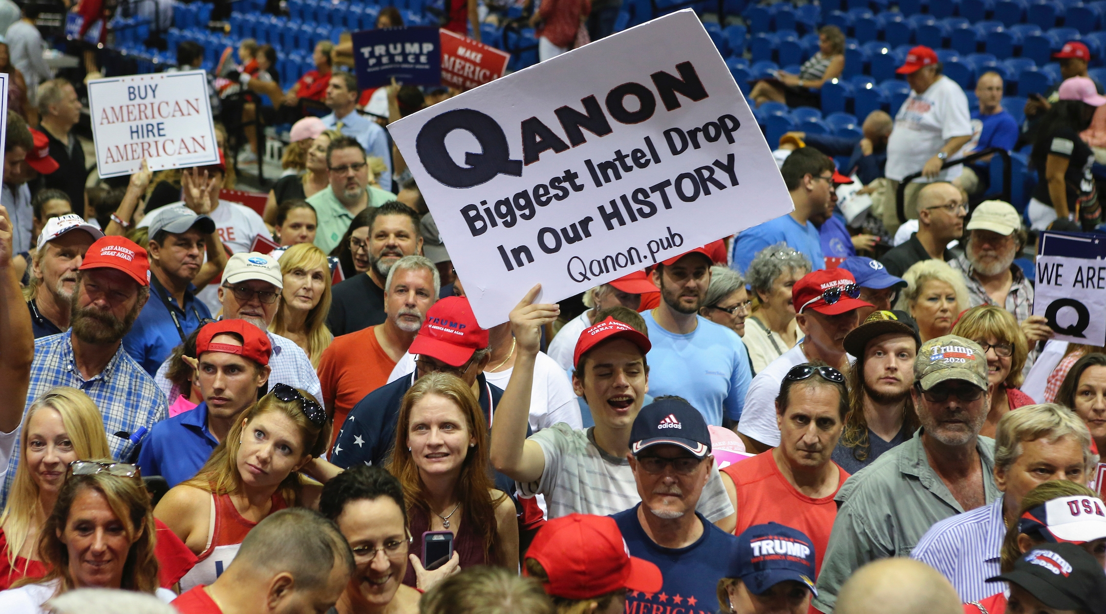 Trump supporters displaying QAnon posters at a 2018 rally in Florida. Recently, Latinos in the state have been inundared with anti-Semitic messages, many relating to the false QAnon conspiracy theory. (Thomas O'Neill/NurPhoto via Getty Images)