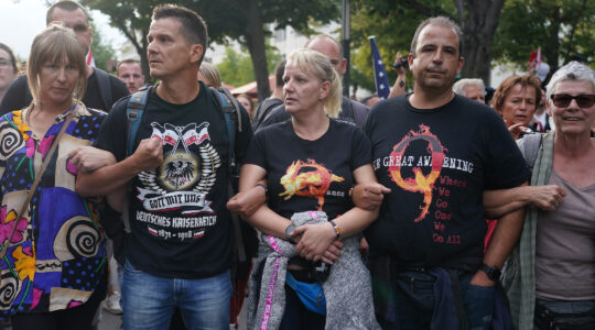 A group of Germans who follow the QAnon conspiracy theory protest in Berlin on August 29. That day, inspired by QAnon, a group of German extremists stormed the country's parliament. (Sean Gallup/Getty Images)