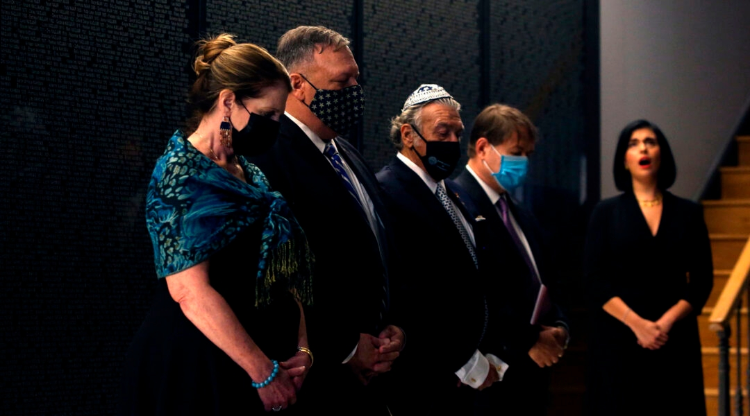 U.S. Secretary of State Mike Pompeo and his wife, Susan, left, visit the Jewish Museum of Thessaloniki, Greece with members of the local Jewish community on Sept. 28, 2020. (Giannis Papanikos/AFP via Getty Images)