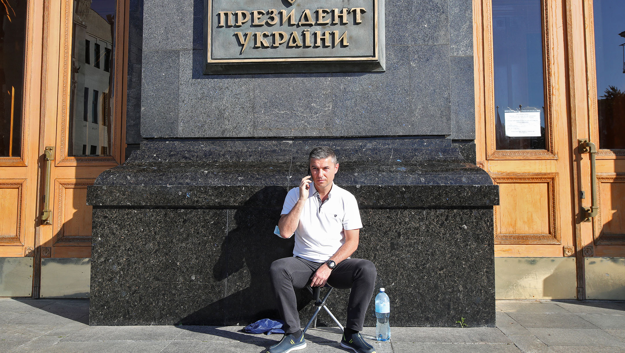 Oleksandr Tsebriy, the mayor of Uman, speaks on the phone outside the Cabinet of Ministers of Ukraine, Kyiv, Ukraine on Aug. 17, 2020. (Pavlo Bahmut/ Ukrinform/Barcroft Media via Getty Images)