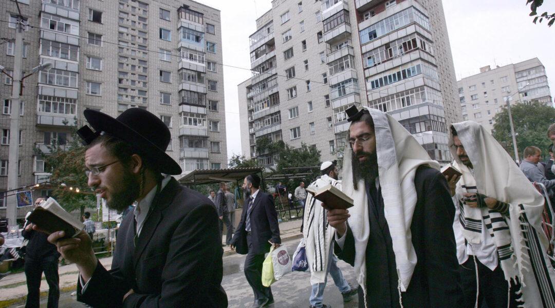 Jews pray on a street near the tomb of Reb Nachman of Breslov in Uman, Ukraine, on Sept. 20, 2006. (Menahem Kahana/AFP via Getty Images)