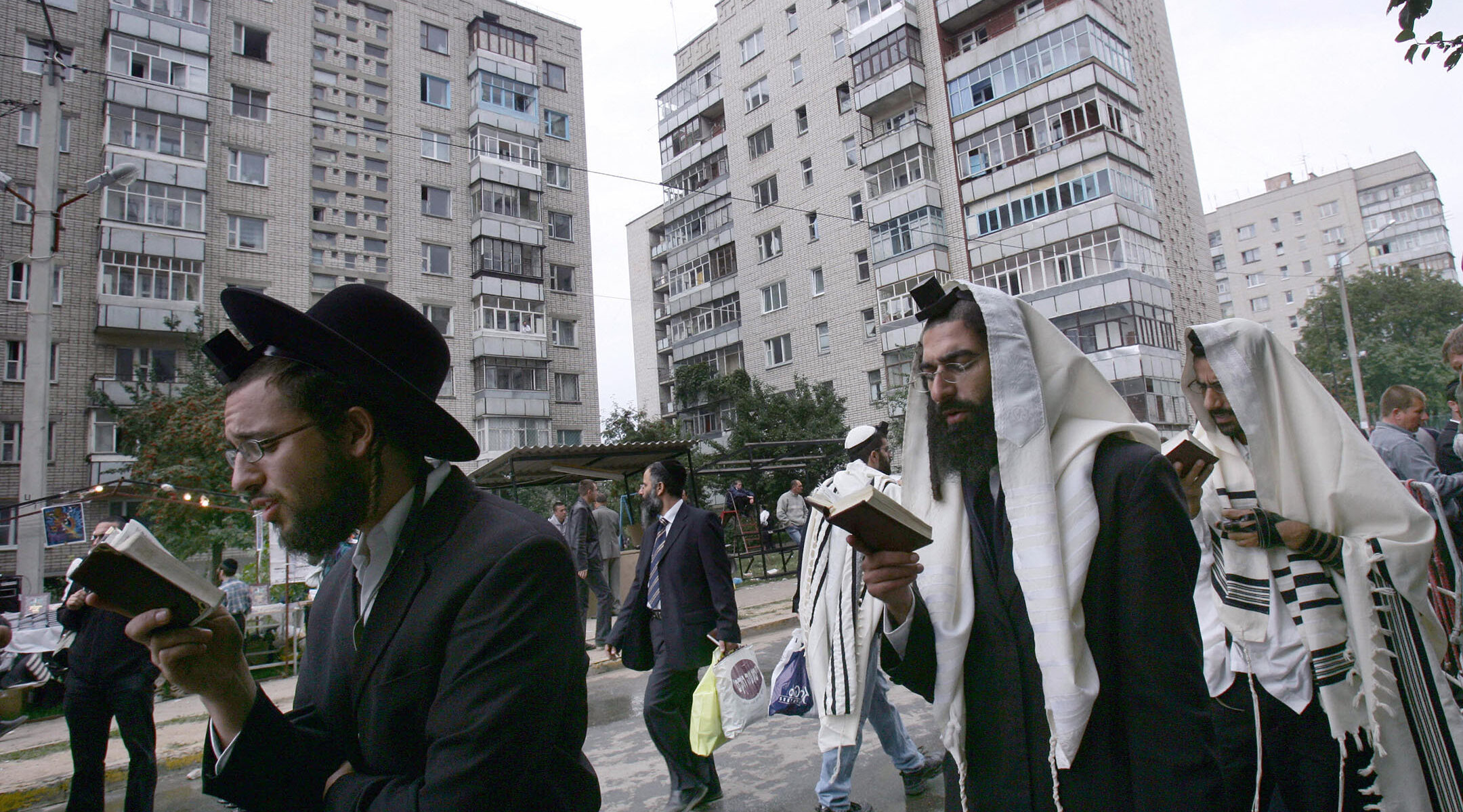 Jews pray on a street near the tomb of Reb Nachman of Breslov in Uman, Ukraine, on Sept. 20, 2006. (Menahem Kahana/AFP via Getty Images)