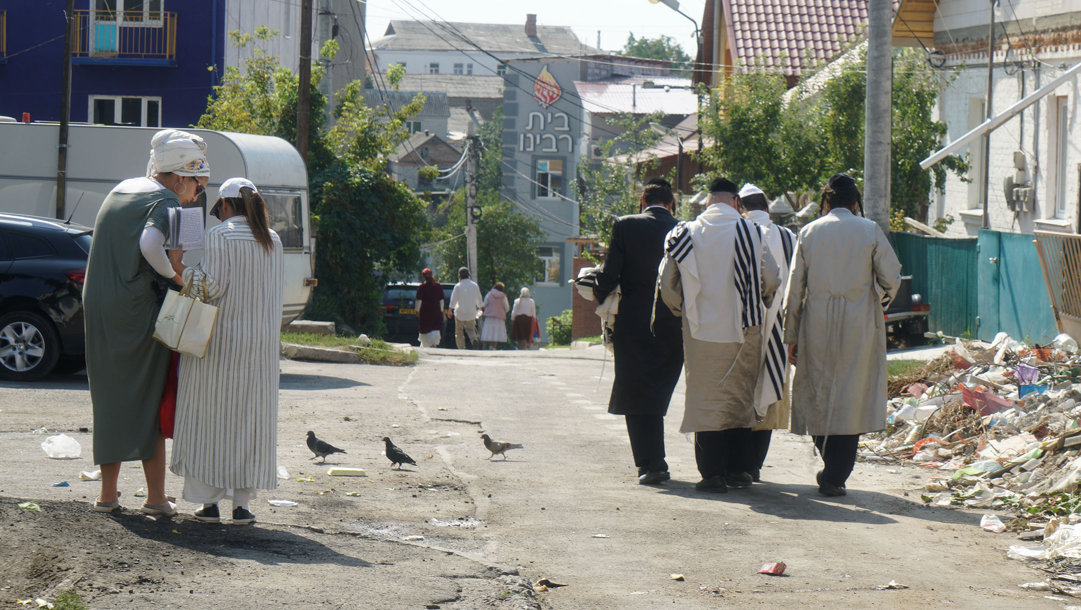 Jews walk down an alley leading to Pushkina Street in Uman, Ukraine on Sept. 8, 2017. (Cnaan Liphshiz)