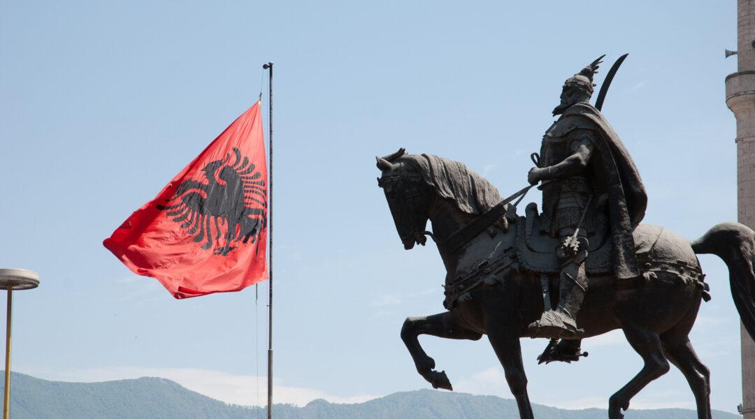 The Albanian flag flies over Skanderbeg Square in Tirana, Albania on May 12, 2010. (Flickr/Thomas Quine)