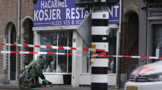 Police investigate a suspect package outside the kosher HaCarmel restaurant in Amsterdam, the Netherlands on January 15, 2020. (Paulo Amorim/NurPhoto via Getty Images)