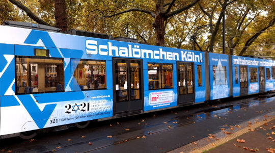 A tram featuring Star of David stickers pulls up to a halt in Cologne, Germany on Oct. 21, 2020. (Courtesy of Synagogue Community Cologne)