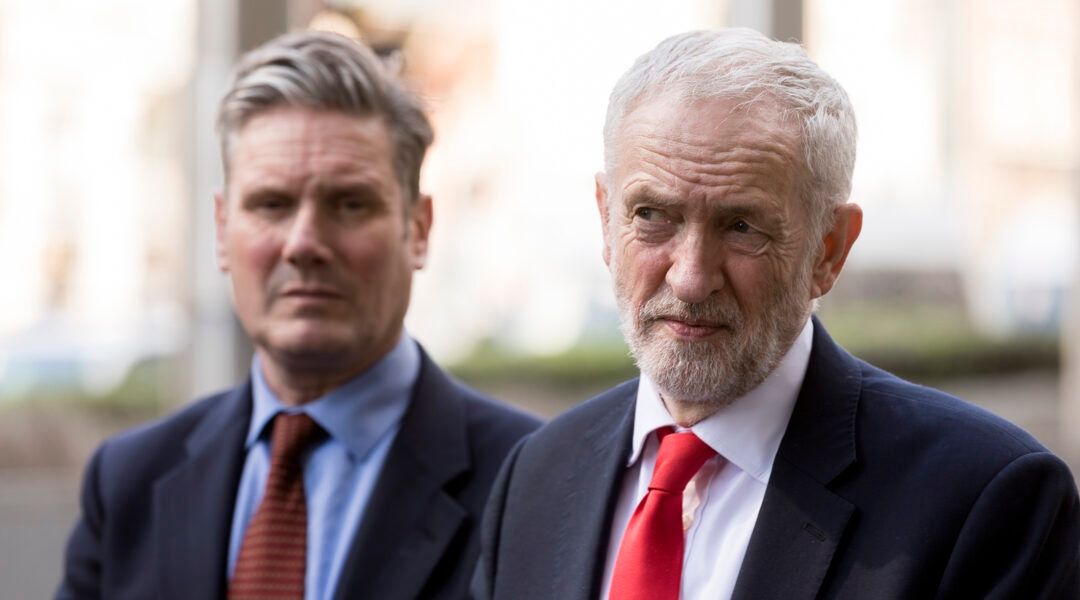 Former Labour leader Jeremy Corbyn, right, and his successor Keir Starmer talk to journalists in Brussels, Belgium on March 21, 2019. (Thierry Monasse/Getty Images)